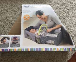 Infant travel bed - easily carried and foldable
