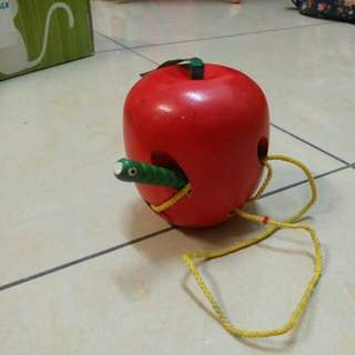 Apple with worm toy