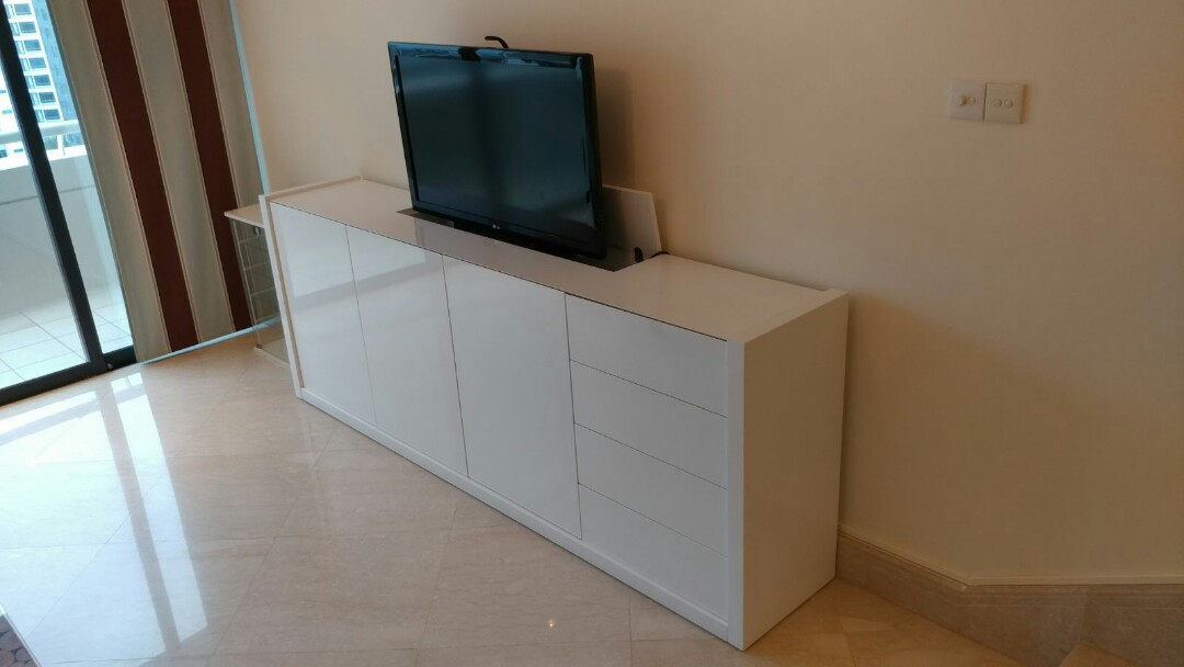 Tv Cabinet With Mechanism To Retract