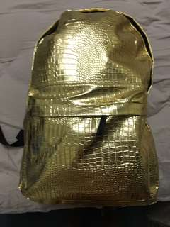 Gold backpack faux animal