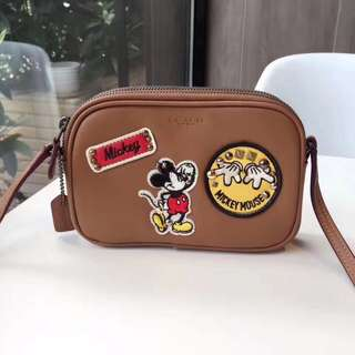 Coach crossbody pouch in glove calf leather with mickey patches
