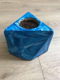 Blue painted concrete planter