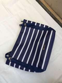 stripped hand bag