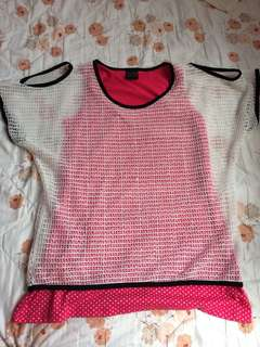White net covered pink sleeveless top