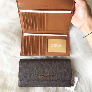 Authentic Michael kors trifold wallet signature brown (18 card slots)