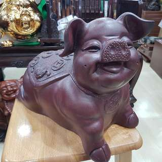 Purple clay smiling PIG