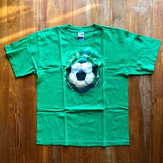 Champion green shirt-sleeved tee with soccer ball print