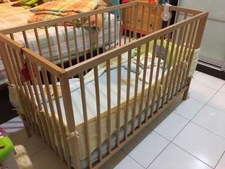 IKEA baby bed frame and fisher price rocker