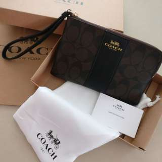 100% authentic Coach wristlet brand new