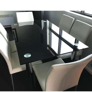 Dining Table, Dark glass with chrome legs, comes with 6 white leather chairs