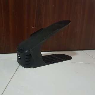 Adjustable shoe stacker