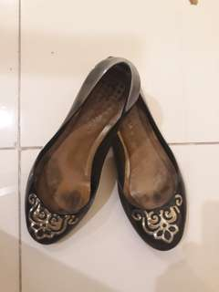 Black shoes with gold design