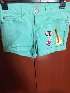 Mint green shorts with patch