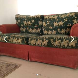 Green and red sofa bed