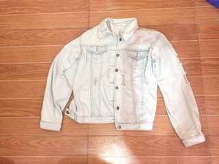 faded ripped denim jacket