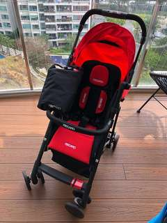 Selling Recaro Easylife stroller in red and black frame (lightly used) with rain cover and stroller bar.