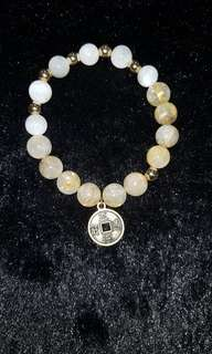 Moonstones with gold rutile .Element of gold series