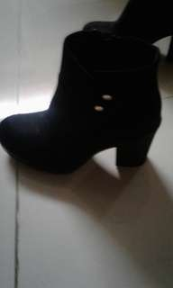 Pair of black chunky heels boots