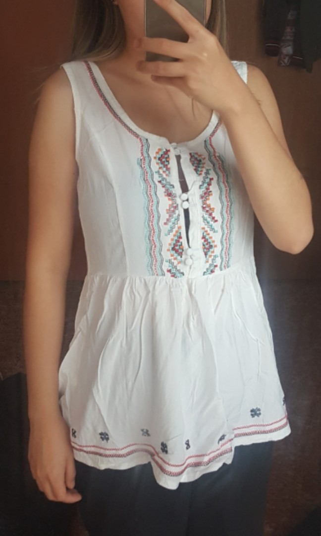 Sleeveless white top