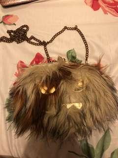 ALDO monster fur sling bag