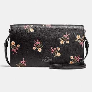 COACH floral bow print crossbody clutch