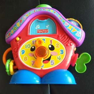 Fisher price peek a boo clock (song, light and rattle)