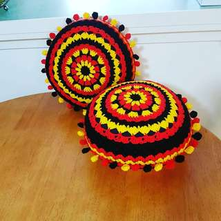Crocheted pom pom cushions