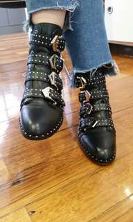 Studded black boots