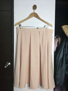 Plus size pink pleated skirt