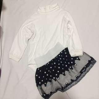 Turtleneck onesie and polkadot skirt