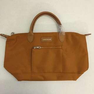 Longchamp bag with sli g