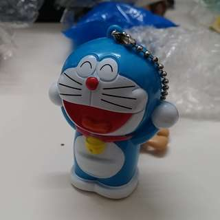 Doraemon with pull back action dinosaur at the back (Japan)
