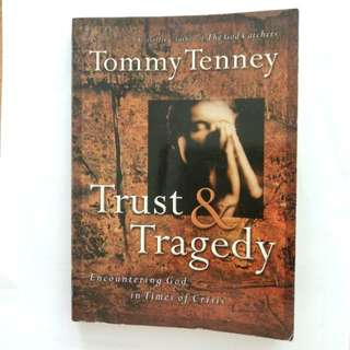 Trust & Tragedy. Encountering God in Times of Crisis. Written by Tommy Tenney. Bestselling Author of The God Catchers.