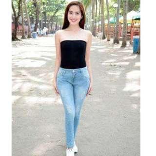 Light wash tattered denim jeans