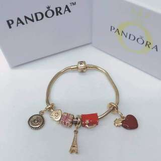 Pandora bracelet with charms gold