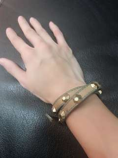 Firm on the price.  good condition authentic tory burch studded olive wrap bracelet