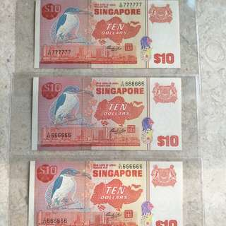 SINGAPORE $10 BIRD GOLDEN SOLID S/N UNC