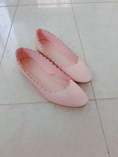 Pink flats with scallop details