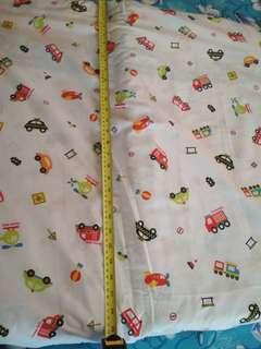 Playpen mattress with bedsheet