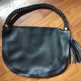 Black pseudo leather shoulder bag with tassel