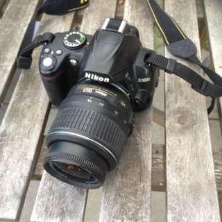 Nikon D3000 body and lens