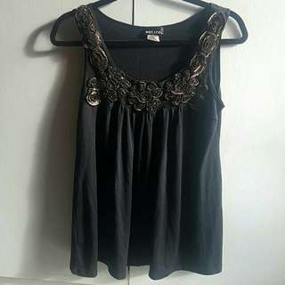 Wet Seal black sleeveless top with floral detail