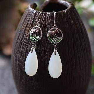 Hetian jade drop earrings.