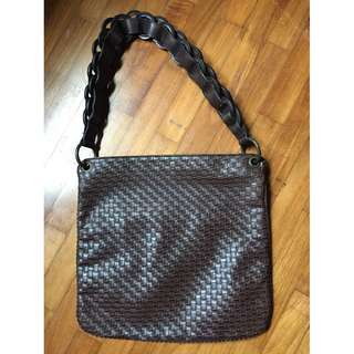 Brown pseudo lather shoulder bag with weaving patterns