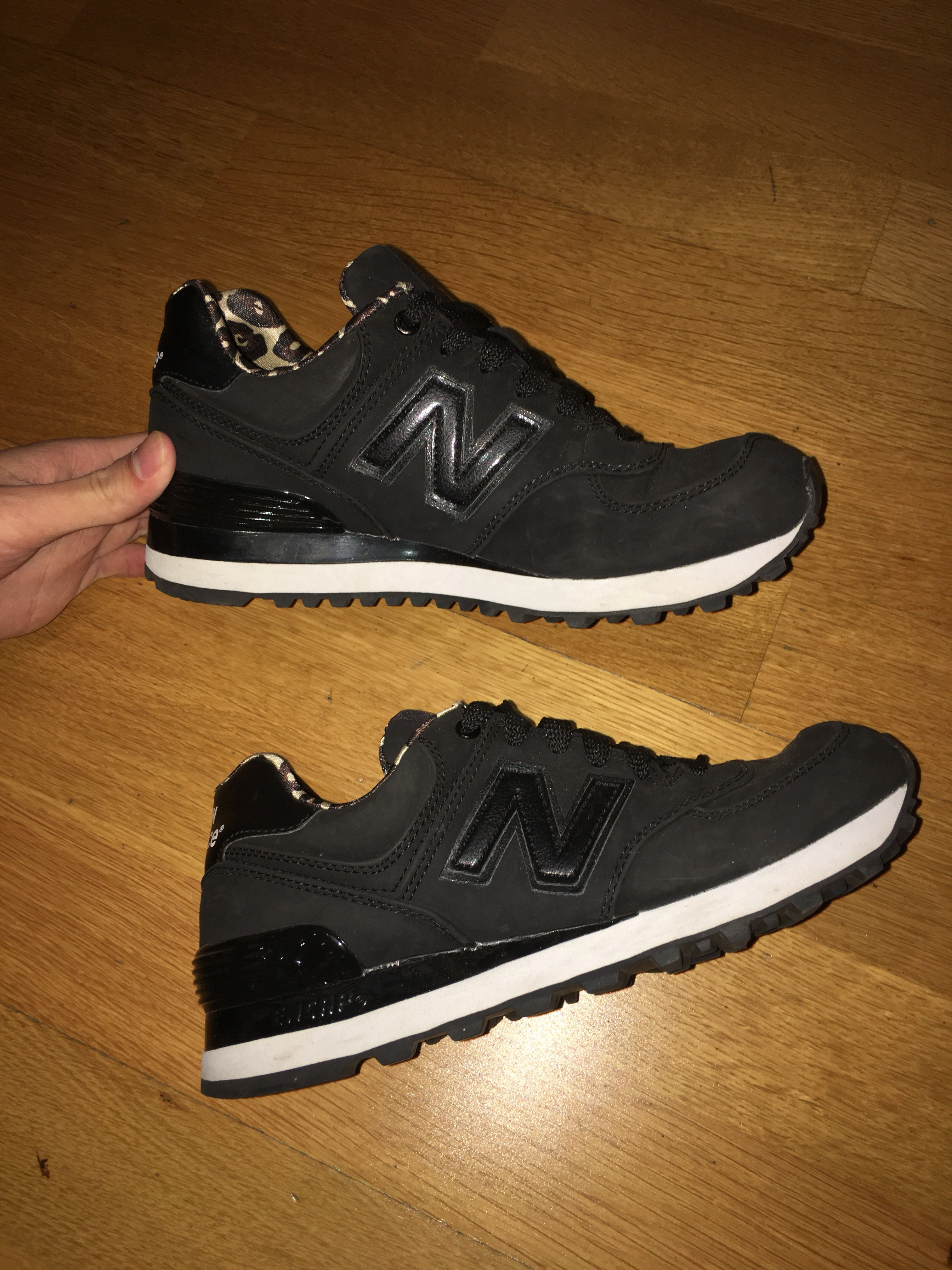 New Balance black and leopard sneakers