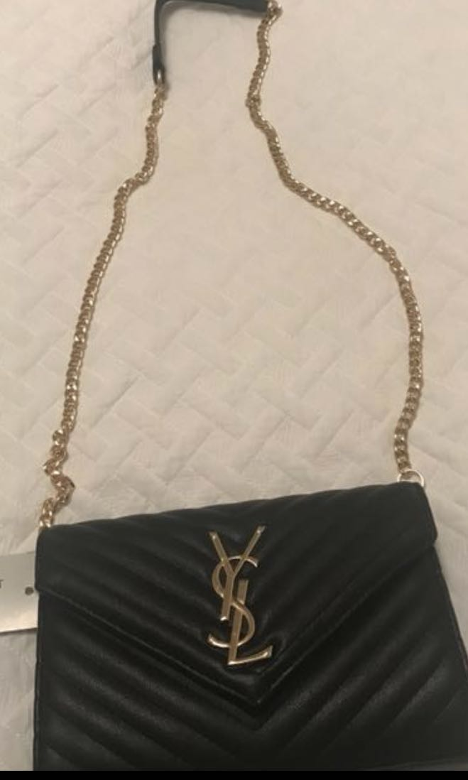 YSL clutch with chain