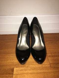 Glossy black pumps