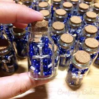 Rosary in a cork bottle