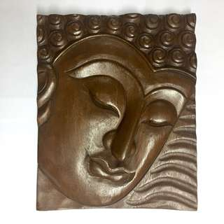 Buddha face wood carving