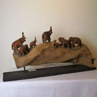 Antique elephant on tree trunk wood carving